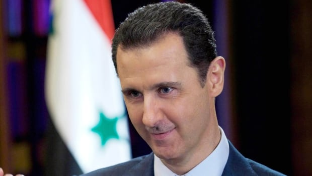 "Syrian President Bashar al-Assad said the country needs a national unity government that would secure the transition to a new constitution, rejecting the ""transitional body"" demanded by the opposition, which wants him to step down."