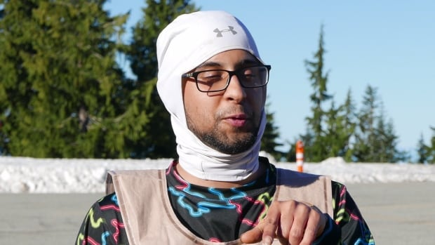 Gursh Singh, 26, of Kent, Wash. speaks to reporters after his cold, wet night on Mount Seymour.
