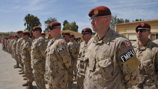 Canadian military police officers are shown during a transfer of responsibility parade in the Sinai, Egypt in March, 2015. Canadian members of the multinational peacekeeping force in Egypt face increasing threats from ISIS, according to a government briefing note.