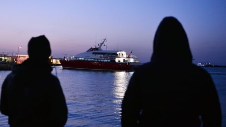 Refugees in Chios watch Turkish ship arrive April 4 2016