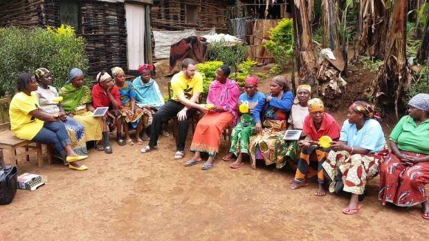 Adam Camenzuli and a group of Tanzanian women