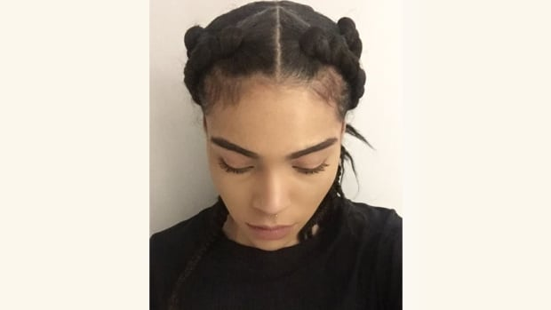 Cree Ballah models the hairstyle she was wearing the day she says two managers at the Zara store she works at tried to change her hair in full view of other employees.