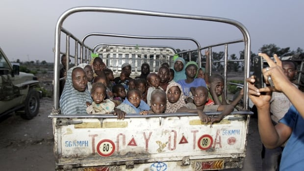 Women and children rescued from Islamist militant group Boko Haram in the Sambisa forest by the Nigerian military arrive at an internally displaced people's camp in Yola, Adamawa State, Nigeria, on May 2, 2015.  There's been a ten-fold increase in child suicide bombers deployed by Boko Haram over the last year, UNICEF says.