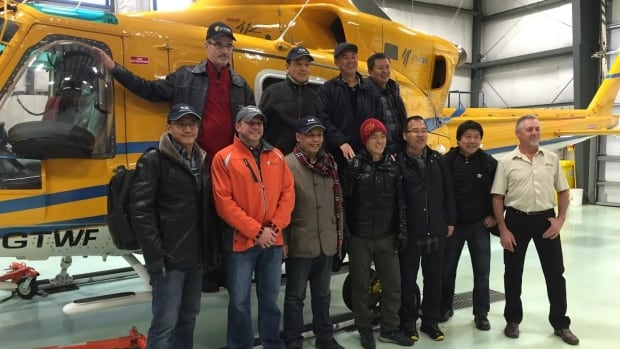 Seven engineers from China Rail, along with officials from KWG Resources, flew by helicopter from Thunder Bay this month to the Ring of Fire region in northern Ontario. The crew will restart the work it began in 2010 to plot out a railroad to access the mining area. (Jeff Walters/CBC)