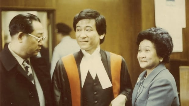 Justice Randall Wong with his parents during his appointment to the provincial court.