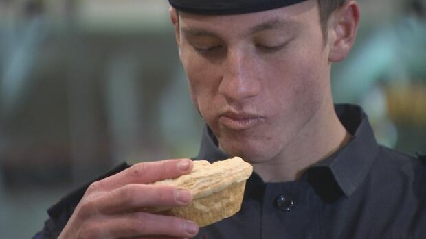 Traditional New Zealand meat pie agrees with this sailor. The pie was served as part of Anzac Day ceremonies on HMCS Montréal.