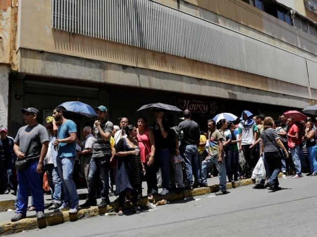 So much is riding on the onset of the rainy season in Venezuela, where people across the drought-stricken country lined up on April 28, 2016, to buy food. So far, Caracas is being spared from energy-saving blackouts but its suburbs are increasingly being left in the dark.
