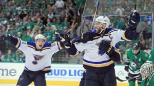 David Backes scores in overtime, Blues even series with Stars
