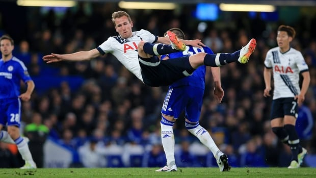 Tottenham Hotspur's Harry Kane, left, and Chelsea's John Terry in action during the English Premier League soccer match between Chelsea and Tottenham Hotspur at Stamford Bridge stadium in London, Monday, May 2, 2016.