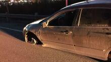 Car with wheel missing traffic stop Mount Pearl Kenmount Road
