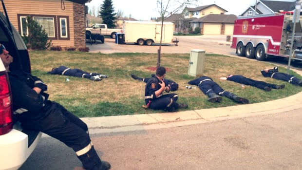 Strathcona County firefighters sent to Fort McMurray take their first break on Wednesday after hours of trying to save homes in the city.