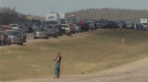 Fort McMurray evacuees rely on convoy, airlift to escape wildfire