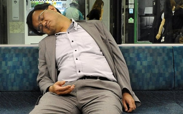 Sleeping Japanese commuter