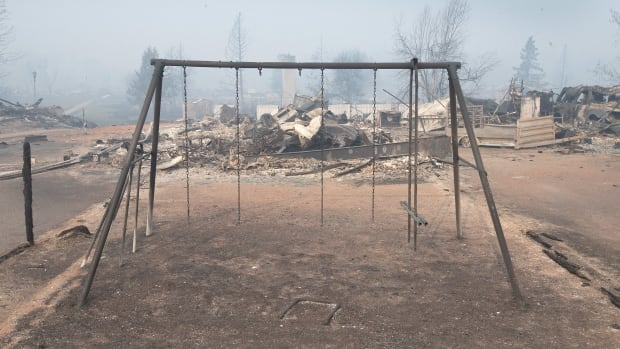 A badly damaged swing set sits in a residential neighborhood destroyed by the fire in Fort McMurray, which is still burning out of control.