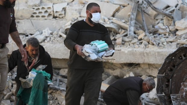 People carry medical supplies found under the rubble of a destroyed Doctors Without Borders-supported hospital hit by missiles in Marat Numan, Syria, in February.  Physicians for Human Rights says more than 730 medical staff have been killed since the war in Syria began in 2011.  Three health-care centres were recently attacked within one week in the city of Aleppo alone.