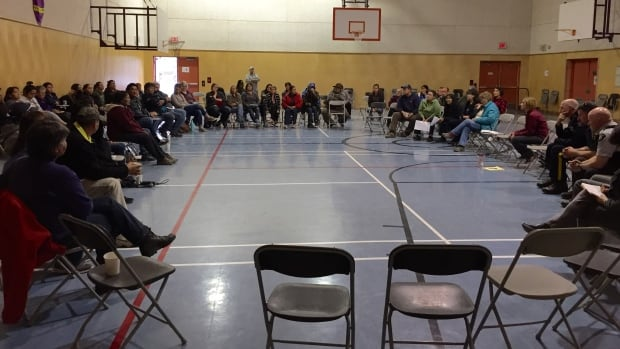 Yukon's chief coroner Kirsten MacDonald met with about 100 residents of Ross River Monday night to talk about the death of Shane Glada, who was killed by dogs in the community last fall.