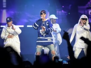 Stratford, Ont., native Justin Bieber wears a Maple Leafs jersey on stage for during the first of his two Toronto concerts on his Purpose world tour on May 18, 2016. For all the adulation from the crowd, Bieber barely cracked a smile during the performance.