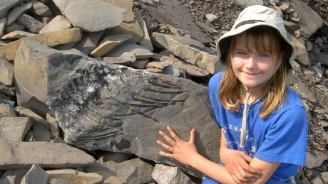 Girl with marine reptile fossil ribs
