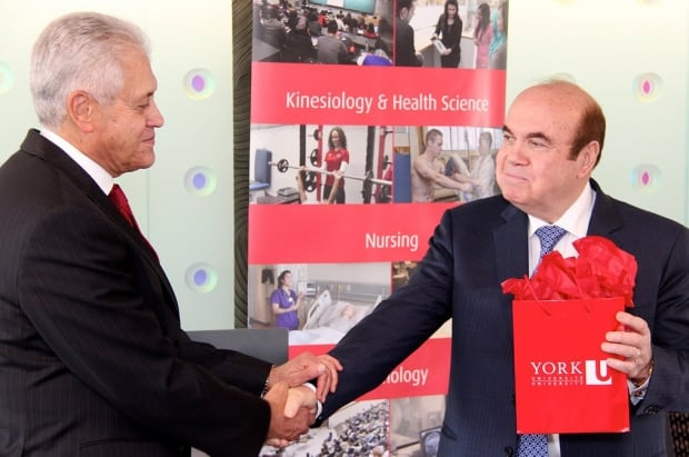 York University president Mamdouh Shoukri shakes hands with businessman Victor Dahdaleh
