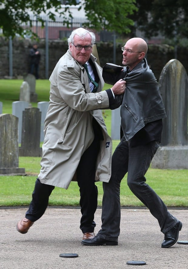 Ambassador Grabs Protestor Kevin Vickers