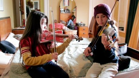 Youth orchestra that plays instruments made from garbage performs in Vancouver