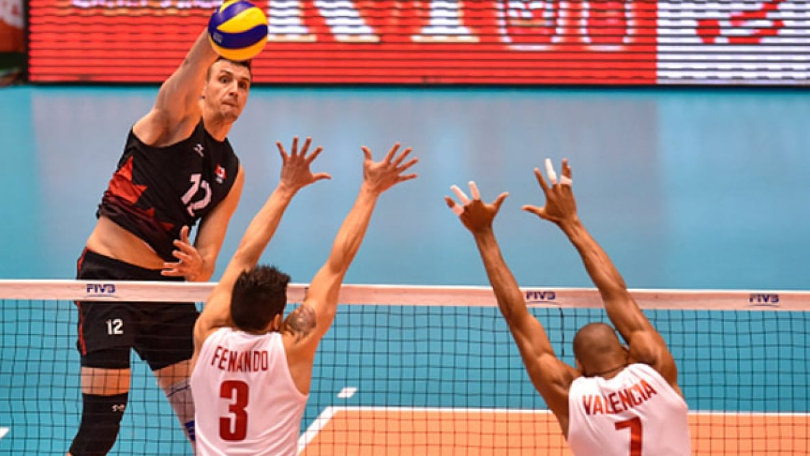Canadian men rallying at final volleyball Olympic ...