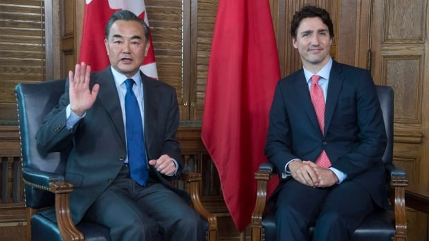 Prime Minister Justin Trudeau met with Chinese Foreign Minister Wang Yi in Ottawa in June. The federal government is looking to double the number of offices in China where people can apply for Canadian visas.