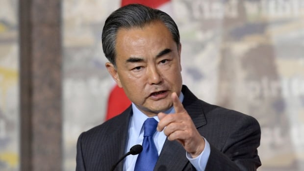 China's Minister of Foreign Affairs Wang Yi scolds a Canadian journalist during a press conference with Canadian Minister of Foreign Affairs Stephane Dion.
