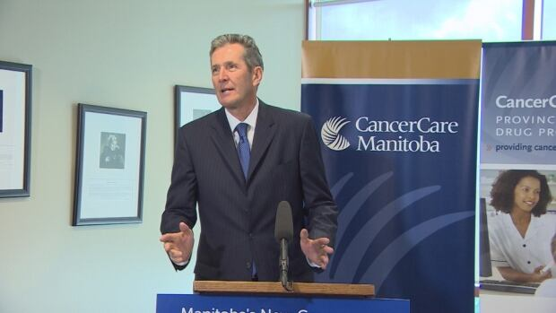 Brian Pallister announces an additional $4 million in funding for cancer treatment drugs at CancerCare Manitoba on Monday.