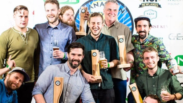 The Four Winds team celebrates with their hardware at the 2016 Canadian Brewing Awards. The Vancouver brewery won the Beer of the Year award for their dry-hopped sour, Nectarous.