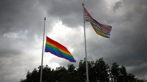 The Pride flag at Vancouver city hall flies and half-mast after a massacre left 50 people dead at a gay club in Orlando, Florida.
