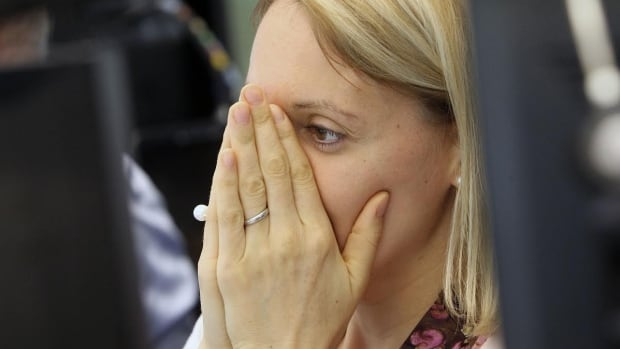 A broker reacts at the German stock exchange in Frankfurt, Germany, on Friday following the Brexit vote. German stocks plunged nearly 10 per cent at the start of trade as markets went into meltdown after Britain voted to leave the European Union.