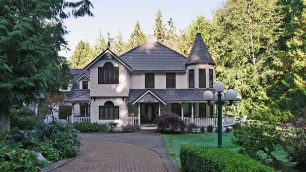 This $3.5 million home in Surrey B.C. is one of four Lower Mainland homes a Chinese bank claims are owned by a fugitive who defaulted on a $10 million loan.