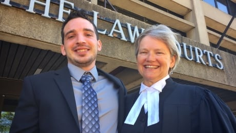 Landon Webb and his lawyer Susanne Litke celebrate outside the court today.