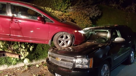 Homeowner startled by bang finds a car on top of his SUV