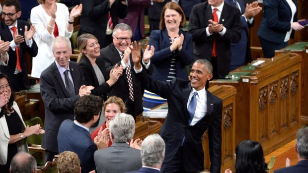 "U.S. President Barack Obama acknowledges people chanting ""Four more years"" after addressing the Parliament in the House of Commons in Ottawa Wednesday."