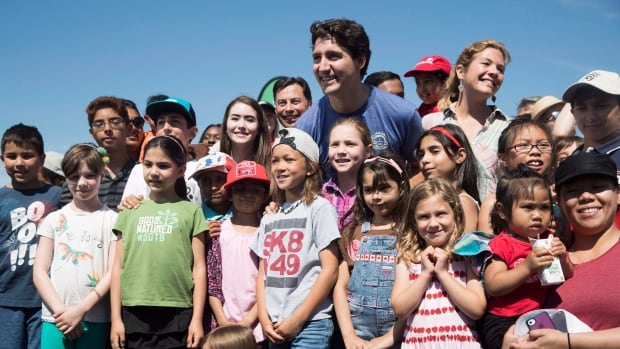 Prime Minister Justin Trudeau and his wife, Sophie Grégoire Trudeau, pose with kids during an event in Toronto last month. Nine in ten Canadian families will be better off once the Canada Child Benefit rolls out July 20, the Liberal government says.