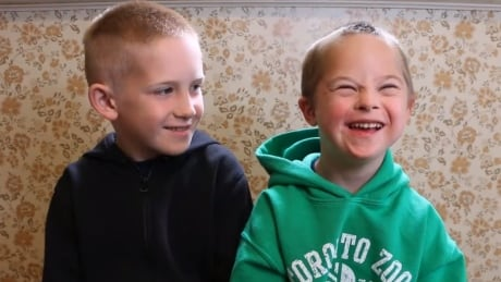 Brothers Griffin and Turner share a laugh in the video.