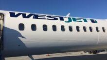 WestJet Encore Dash-8 Q400 passenger plane airlines Saskatoon YXE