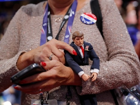 A delegate holds a Trump doll during the second day of the convention.