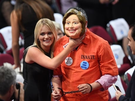 A delegate dressed as U.S. Democratic presidential candidate Hillary Clinton is accosted by another delgate on before the start of the last day of the Republican National Convention.