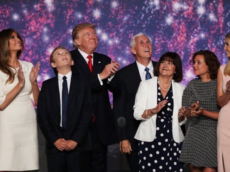 Republican presidential candidate Donald Trump and Republican vice presidential candidate Mike Pence stand with their families at the end of the Republican National Convention in Cleveland, Ohio.