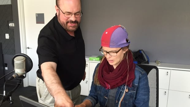 George Townsend walks CBC reporter Marina von Stackelberg through the process of composing emails using the P3000. The device allows users to write, and send emails, using only their brain.