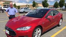 Steve Matusch of Sudbury with his Tesla