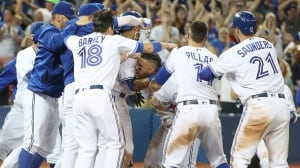 Devon Travis, Blue Jays save 12-inning nail-biter over Padres