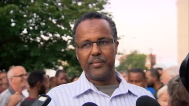 Abdirahman Abdi's brother-in-law Khalif Ismail thanked people at the memorial