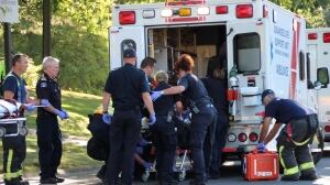 Worker in critical condition after being trapped under lawn mower in Surrey park pond