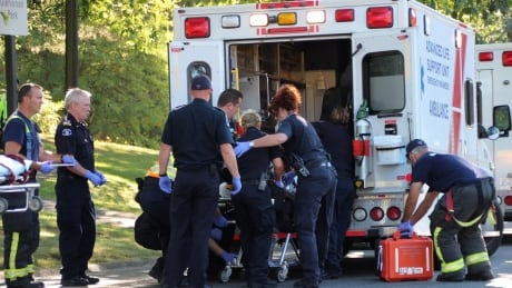 Worker injured after being trapped under lawn mower in Surrey park pond