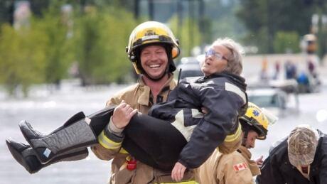 Firefighter Alberta flood
