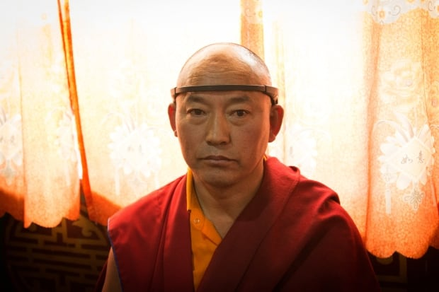 Tibetan monk with monitoring headband